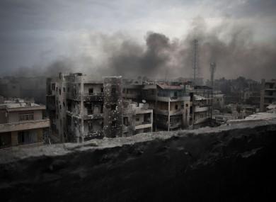 Smoke rises over Saif Al Dawla district, in Aleppo in 2012.