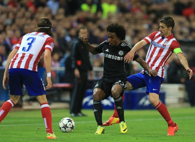 Atletico Madrid's Gabi (right) and Filipe Luis battle for the ball with Chelsea's Willian.