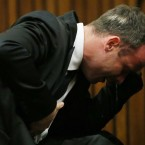 Oscar Pistorius weeps as he listens to evidence by a pathologist in court in Pretoria, South Africa. Pistorius is charged with murder for the shooting death of his girlfriend Reeva Steenkamp, on Valentine's Day 2013. (AP Photo/Themba Hadebe, Pool)<span class=