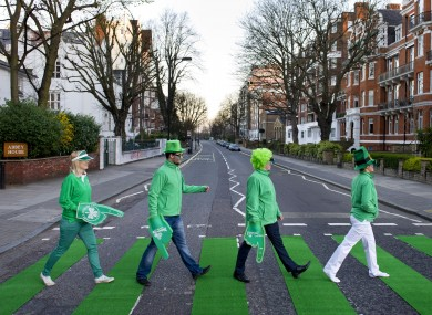 The zebra crossing on Abbey Road is turned green for St Patrick's Day.