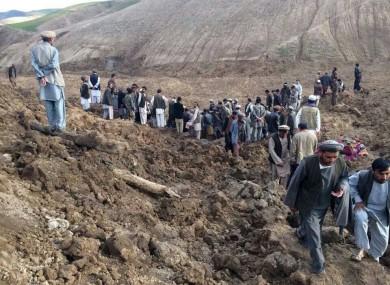 Afghans search for survivors after a massive landslide landslide buried a village.