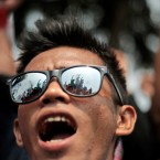 A worker shout slogans during a May Day rally outside the presidential palace in Jakarta, Indonesia.<span class=