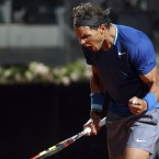 Rafael Nadal celebrates after winning a point against France's Gilles Simon.<span class=