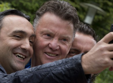 A Netherlands fans takes a picture with national boss Van Gaal this weekend.