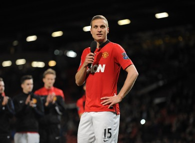 Manchester United's Nemanja Vidic speaks to the crowd during after the final whistle in his last home game for the club.