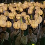 South Korean Buddhists carry lanterns in a parade for cherishing the memory of deceased persons and safe return of passengers aboard the sunken ferry boat Sewol, during the Lotus Lantern Festiva. <span class=