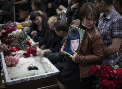 Mourners at the funeral of a 21-year-old believed to be killed by shots from a Ukrainian military column.