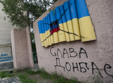 A concrete depiction of the yellow-blue Ukrainian flag painted over with the flag of the Donetsk republic in Artemovsk, eastern Ukraine.