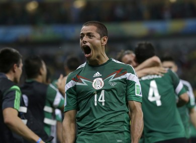 Mexico's Javier Hernandez celebrates after his team scored its first goal against Croatia.