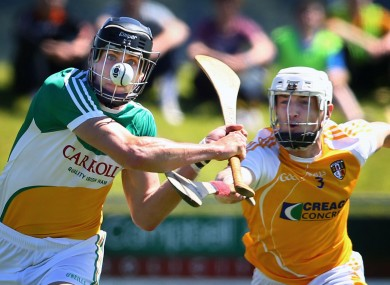 Conor McKinley with Offaly's Conor Mahon today.
