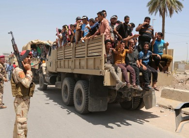 raqi men leave the main military recruiting center to join the Iraqi army after volunteering for military service in Baghdad after authorities urged Iraqis to help battle insurgents.