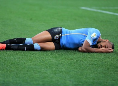 Alvaro Pereira after a coming together with England's Raheem Sterling.