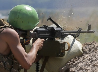 A Ukrainian soldier shoots from a machine gun during a battle with pro-Russian separatist fighters in Slovyansk.