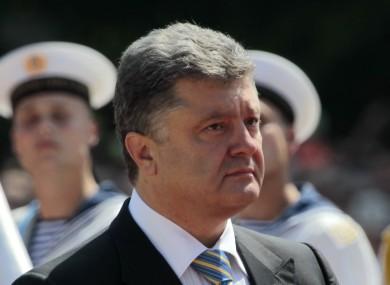 Ukrainian President Petro Poroshenko reviews an honor guard after the inauguration ceremony in Sophia Square in Kiev.