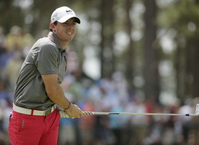 Rory McIlroy watches his tee shot on the 13th hole.