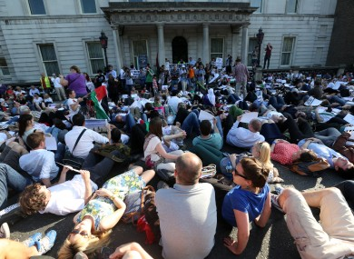 Hundreds of protesters lie down in front of the Department of Foreign Affairs in Dublin last week.