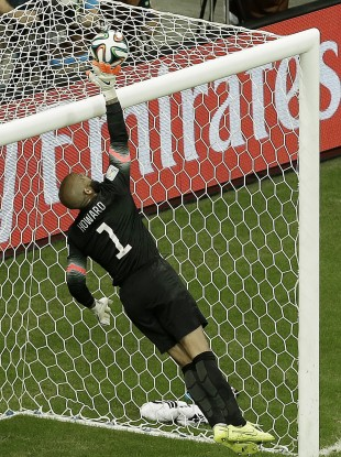 United States' goalkeeper Tim Howard deflects the ball over the crossbar during the World Cup round of 16 soccer match between Belgium and the USA.