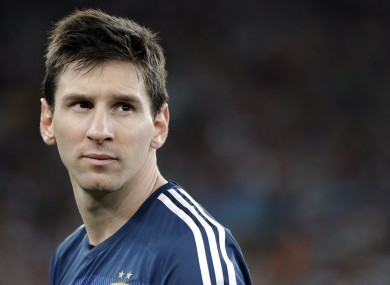 Argentina's Lionel Messi looks back as he goes up to get his runner-up medal.