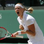 Petra Kvitova of Czech Republic celebrates winning the first set as she plays against Lucie Safarova of Czech Republic during their women's singles semifinal match at the All England Lawn Tennis Championships in Wimbledon.<span class=