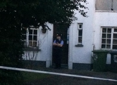 A garda stands at the door of the house where the incident took place.