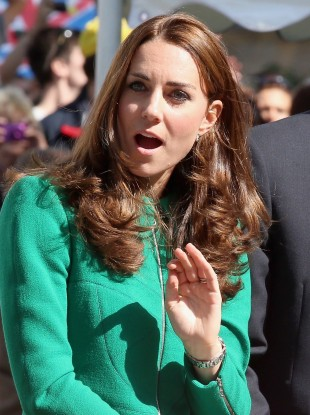 The Duchess of Cambridge reacts as Mark Cavendish (not pictured) falls from his bike.