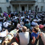 Hundreds of protesters lie down in front of the Department of Foreign Affairs in Dublin.<span class=