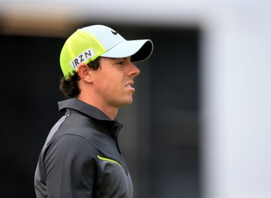 Rory McIlroy hit the turn, at Hoylake, two shots clear.