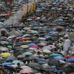Hong Kong residents marched through the streets of the former British colony to push for greater democracy in a rally fuelled by anger over Beijing's recent warning that it holds the ultimate authority over the southern Chinese financial centre.<span class=