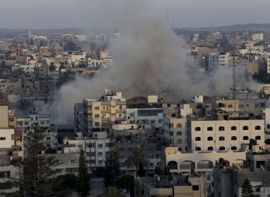 Smoke rises following an Israeli strike on Gaza Strip, Friday, July 11, 2014.