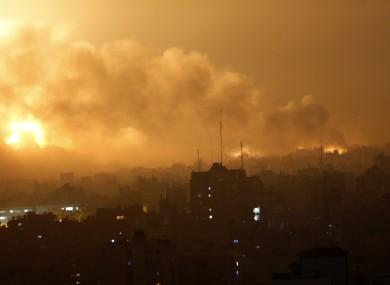 Smoke rises as flames spread across buildings after Israeli strikes in the Shijaiyah neighborhood in Gaza City.