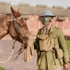 A soldier and horse wear gas masks at the Canadian Army Veterinary Corps Headquarters.<span class=