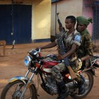 Ex-Seleka fighters ride on a motorcycle in Bambari, Central African Republic.<span class=