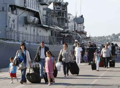 Evacuees disembark from France's Navy frigate