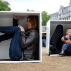 Men, women and children are squashed inside boxes to illustrate the conditions faced by the population of Gaza trapped by the blockade, the wooden boxes, 90cm high by 80cm wide, have been arranged to represent the Gaza strip as a protest by Oxfam on Parliament Square, central London.<span class=