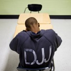 A juvenile resident sits in a classroom at the Department of Juvenile Justice's Metro Regional Youth Detention Center.<span class=