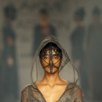 A model displays a creation by a Gen Next designer during the first day of the Lakme Fashion Week in Mumbai.<span class=