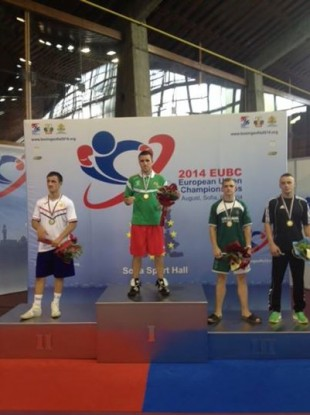 David Joyce wears his gold medal on the podium.