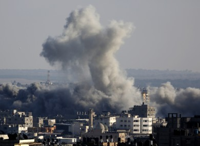 Smoke rises over Gaza City after an Israeli strike on Friday.