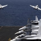 U.S. F/A-18 fighter jets take off for mission in Iraq from the flight deck of the U.S. Navy aircraft carrier USS George H.W. Bush, in the Persian Gulf.<span class=