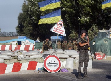 Ukrainian soldiers guard at a checkpoint in the town of Mariupol, eastern Ukraine.