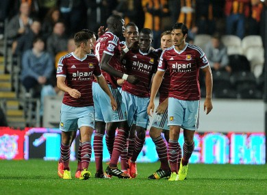 West Ham United's Enner Valencia (centre) is congratulated by his team-mates.