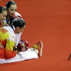 Chinese synchronised swimming team members take selfie with their gold medals after their synchronized swimming team free routine at the 17th Asian Games in Incheon, South Korea.<span class=