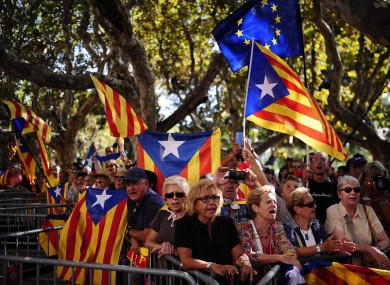 """People wave 'estelada'"""" flags, that symbolize Catalonia's independence, during a demonstration calling for the independence of Catalonia."""