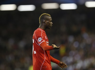 Liverpool's Mario Balotelli gestures during the Champions League group B soccer match between Liverpool and Real Madrid.