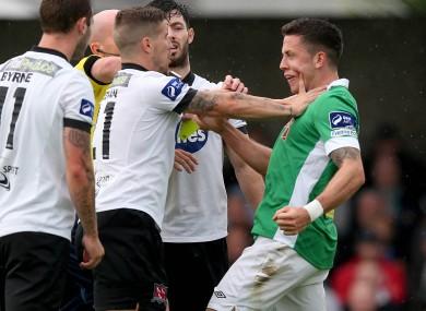 Darren Meenan of Dundalk and Cork's Billy Dennehey when the teams met earlier in the season.