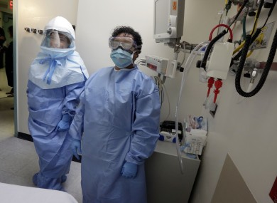 Workers at a Dallas hospital pose in contamination suits.