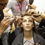A model is made up backstage for Elie Saab's Spring/Summer 2015 ready-to-wear fashion collection presented in Paris.<span class=