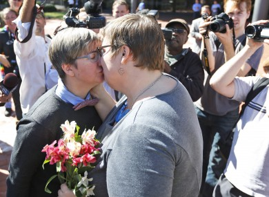 Nicole Pries and Lindsey Oliver share a kiss as they celebrate being one of the first same-sex couples in Virginia to marry.