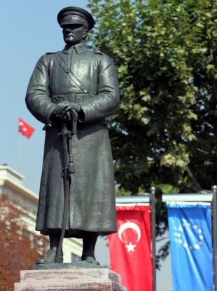 A statue of Mustafa Kemal Ataturk in military uniform