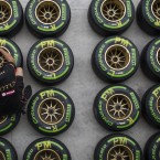 A Lotus crew member marks a tire in the boxes of the Interlagos circuit in Sao Paulo, Brazil.<span class=